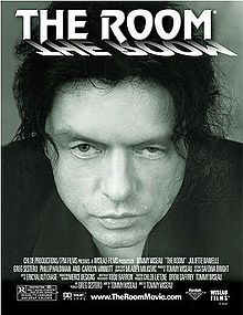 A black-and-white poster for the movie shows Tommy Wiseau's face looking directly at the viewer.