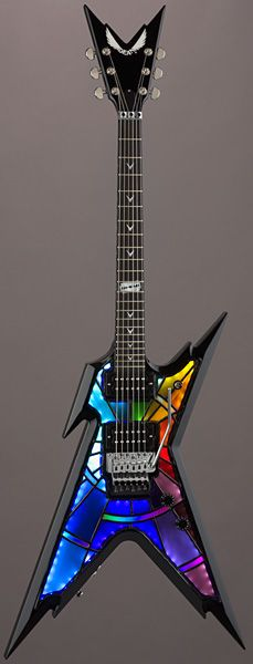 Dean USA Razorback - Stained Glass in #Rainbow colors. V shaped headstock AND fret markers. RESEARCH #DdO:) - https://www.pinterest.com/DianaDeeOsborne/instruments-for-joy/ - INSTRUMENTS FOR JOY. VARIOUS MODELS w dif color patterns available, incl copper tone & brown; wide price range up to above $5,000. Made in USA; Hand-Airbrushed Rusted Metal finish (entire guitar). On Dimebag model is Tribute Crest on Headstock; Pearl Razor Inlay; Floyd Rose tremolo/ whammy bar. www.deanguitars.com