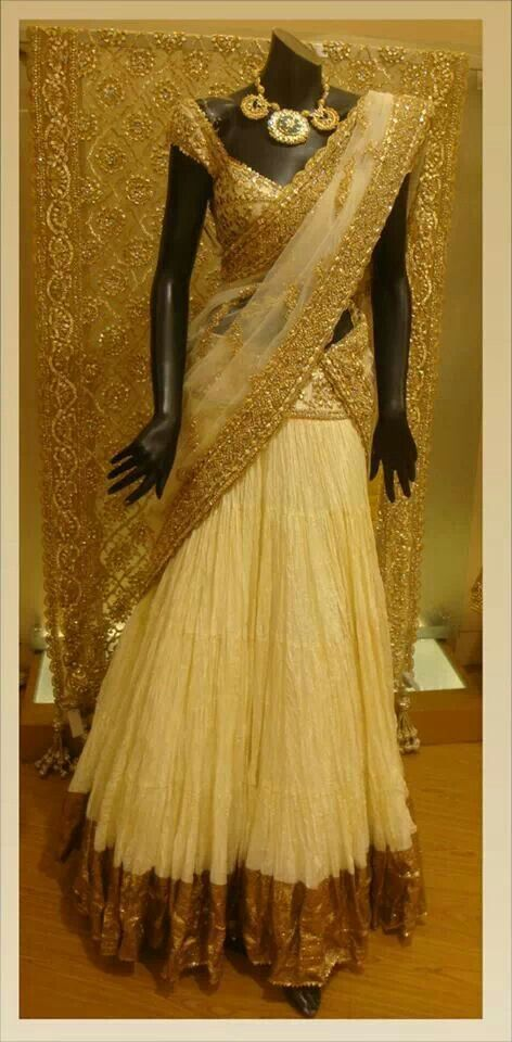 Offwhite Bridal lehenga choli having golden color heavy embroidery on dupatta For more collection visit http://panachehautecouture.co.in/