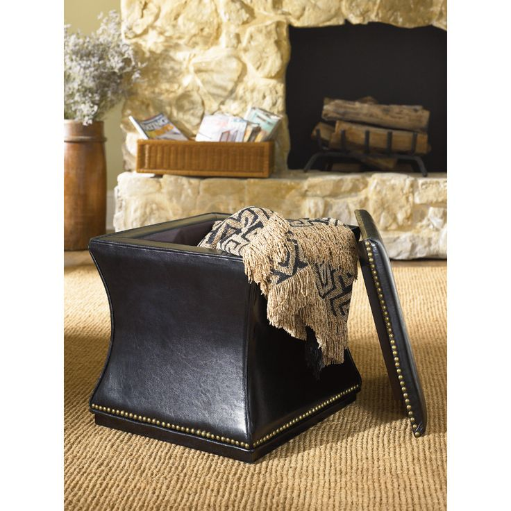 A leather storage cube holds extra throw pillows and blankets and can serve as either an ottoman or extra seating around the coffee table. From the Hidden Treasures collection by Hammary Furniture.