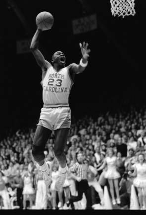 """February 10, 1983: """"Michael Jordan with his mouth open, going up for a slam dunk during a UNC vs. UVA basketball game at Carmichael Auditorium (winning basket in the 64-63 game)."""""""