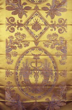 Napoleon's silks include motif of the bee and a version of the caduceus staff of twisted snakes framed by twocornucopia