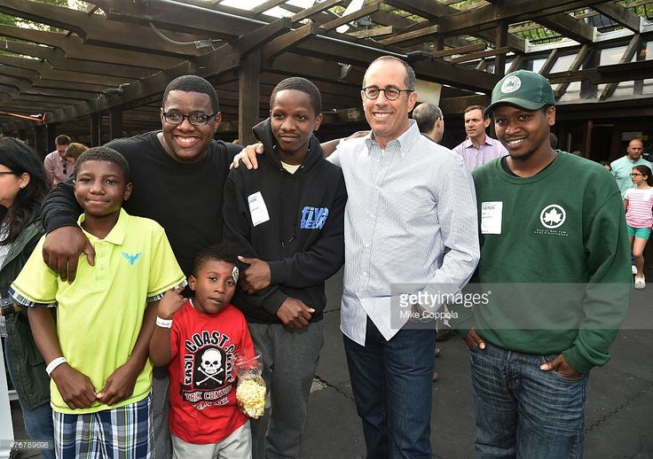 Event Host Jerry Seinfeld with families from the Baby Buggy Fatherhood Program at the 2015 Baby Buggy Bedtime Bash hosted by Jessica and Jerry Seinfeld and sponsored by Destination Maternity at Victorian Gardens at Wollman Rink Central Park on June 3, 2015 in New York City.