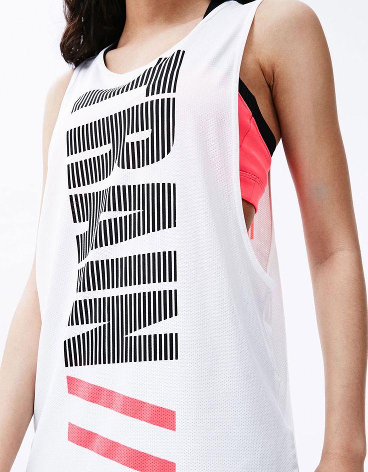 Camiseta ténica sport 'Train Harder '.