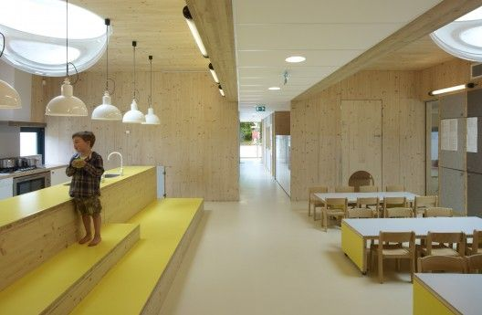 Hestia Day-Care Centre designed by NEXT Architects. Kitchen + Dining - includes scaled furniture and platforms for working at the kitchen bench