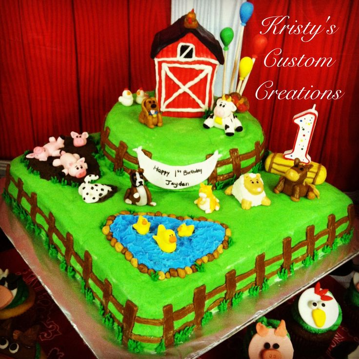 """First Birthday Farm Cake by Kristy's Custom Creations. Yellow butter recipe cake with homemade buttercream. Rice krispie barn covered in marshmallow fondant and hand sculpted marshmallow fondant farm animals, fence posts, hay bale, rocks, birthday sign, and balloons. {I made this cake for my sons 1st birthday. The theme was """"There was a farmer who had a dog and B.I.N.G.O was his name-o"""". My son loves all animals but he especially loves dogs so I meshed the barnyard and dog theme together.}"""