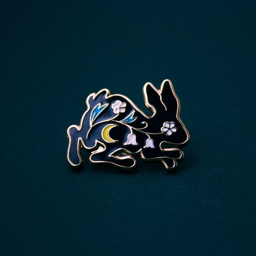 Floral rabbit enamel pin.