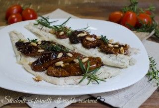 branzino ai pomodori secchi e pinoli al forno ricetta secondo pesce facile veloce spigola cromaris
