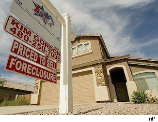 Foreclosed Homes for Sale | Foreclosure surge: a for sale sign outside a foreclosed home