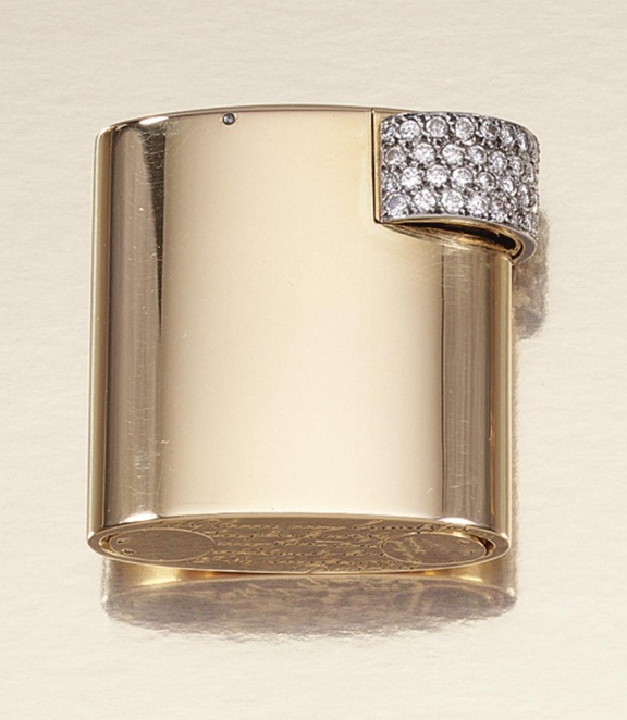 DIAMOND CIGARETTE LIGHTER, CARTIER, 1940S. Of elliptical design embellished with a panel of circular-cut diamonds, signed Cartier Paris and numbered, maker's marks and French assay marks, later fitted case by Cartier Paris.