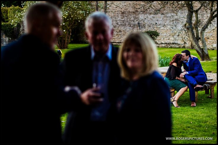 A quiet snog for these wedding guests at Notley Abbey -