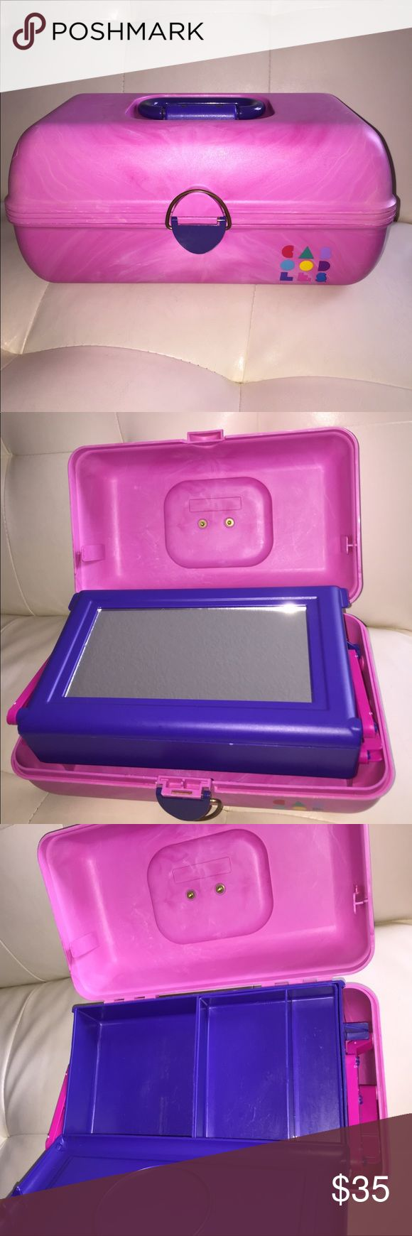 Vintage Caboodles makeup case 🆕📣 Vintage Caboodles makeup case                               One auto open tray Flip lid with mirror Removable accessory tray Spacious interior storage Secure latch                                                                           Colors pink and purple                                                            Great condition with minor wear which is shown in the picture. Caboodles Other