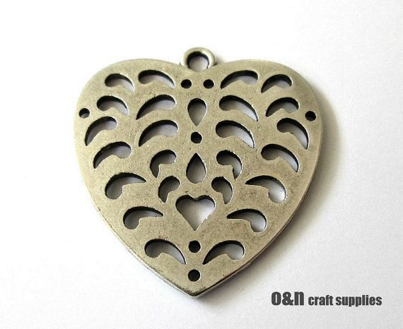 Antique silver heart cut out pendant 1 piece by OandN on Etsy, $1.70  #pendant #jewelrysupplies