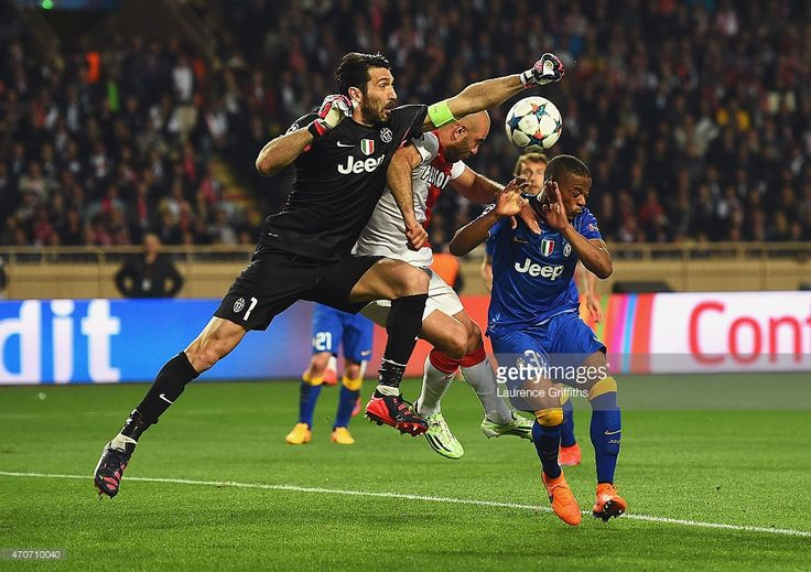 Gianluigi Buffon of Juventus punches clear as Patrice Evra (R) of Juventus takes evasive action during the UEFA Champions League quarter-final second leg match between AS Monaco FC and Juventus at Stade Louis II on April 22, 2015 in Monaco, Monaco.