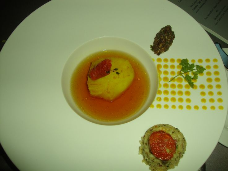Chilean Sea Bass in a tomato broth with a Mediterranean couscous
