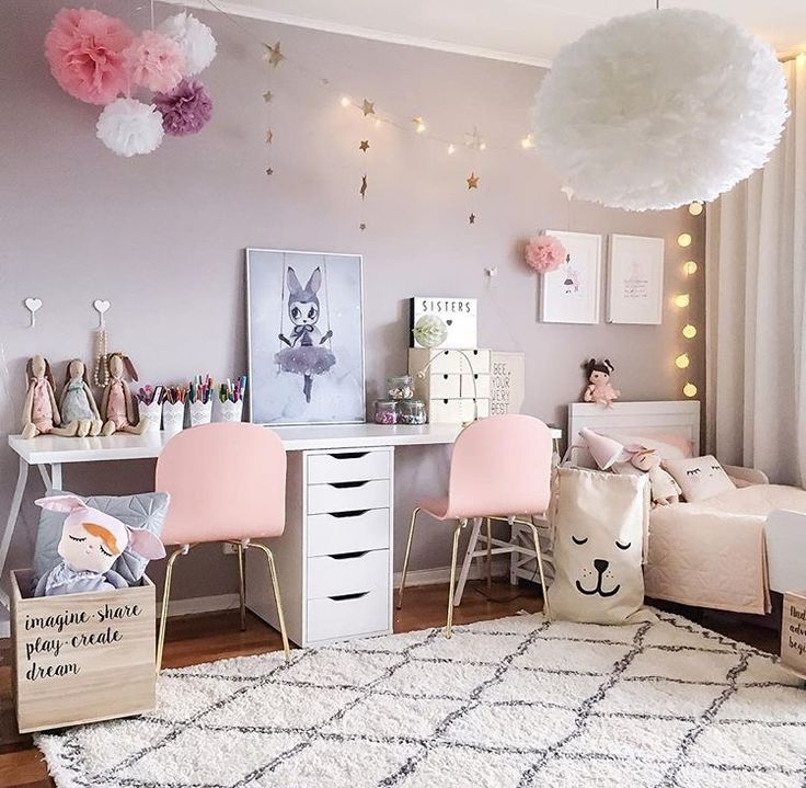 Sweet colours of white and blush make this girls room light and dreamy