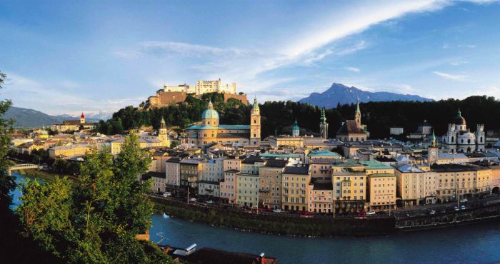 4- Salzburg, Austria  Salzburg is probably the most relaxed city in Austria. You're able to just rent a bike here and explore the layedback hometown of Mozart, and if you feel like getting a refreshment, you should take a drink in Austria's biggest biergarten called Augustiner Bräu. But, Salzburg has way more to offer then that, since not only the Hohensalzburg castle, but also Mirabell Gardens and Nonnberg Abbey are located in this wonderfull town. Austrian people are very friendly and will…