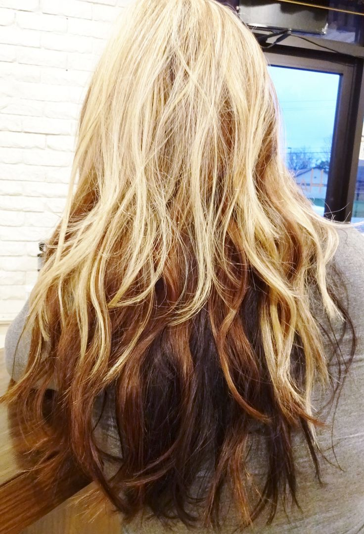 Pale blonde hair color into medium and dark brown lengths.  Color blocking. Blond and brown highlights.