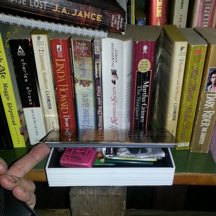 Geocache inside a Little Free Library! Very nice work hollowing out the book and making it look natural. Hopefully no one takes it thinking it's a real book without looking inside. #IBGCp