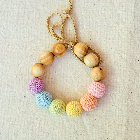 Hey, I found this really awesome Etsy listing at https://www.etsy.com/listing/152085613/neutral-rainbow-wooden-teething-bracelet