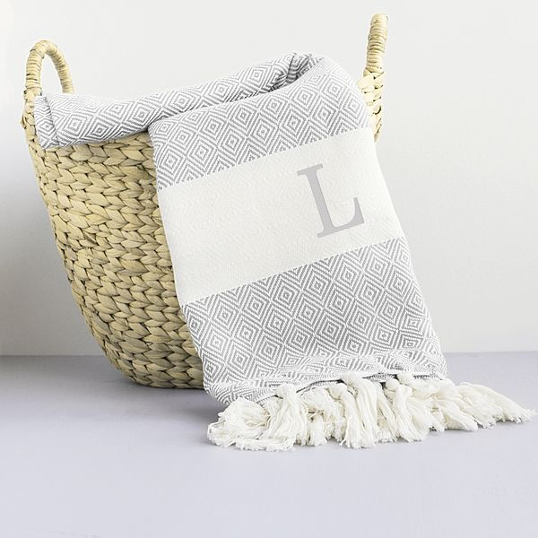 add this throw blanket to your home for a stunning accent made of turkish cotton this grey throw blanket features one embroidered capital