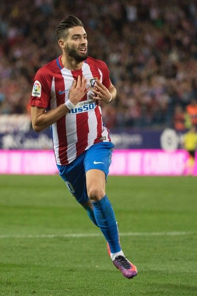 Atletico Madrid's Belgian midfielder Yannick Ferreira Carrasco celebrates after scoring during the Spanish league football match between Club Atletico de Madrid and Malaga CF at the Vicente Calderon stadium in Madrid on October 29, 2016. / AFP / CURTO DE LA TORRE