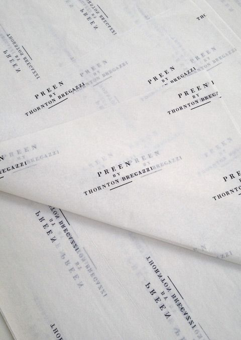 branding, tissue paper, typography, black and white