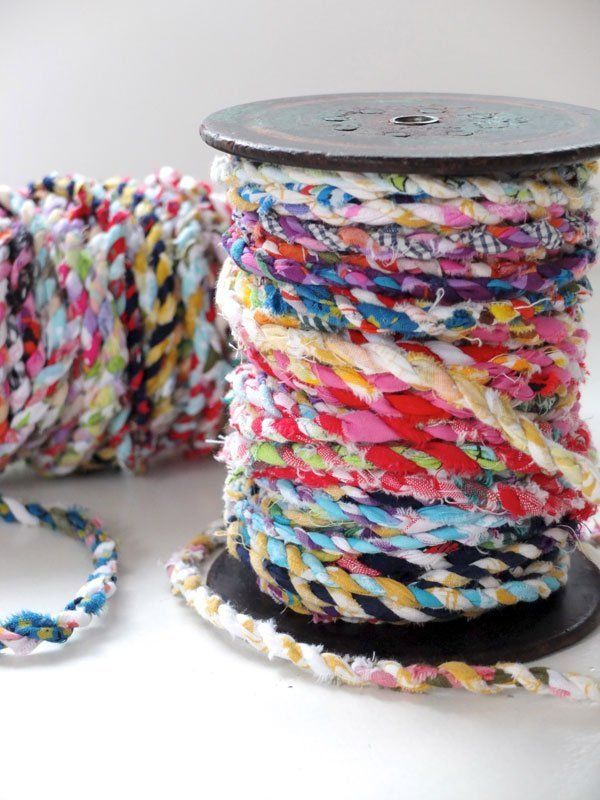 "Do you have an over abundance of fabric scraps that you are holding on to, ""just in case""? Cintia from My Poppet was doing just that, and then she came up with the clever idea of turning her scraps into pretty twine. You can find the simple tutorial below."