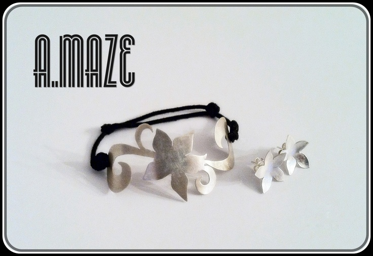 Alexandria set, adjustable bracelet with leather back and a Sterling silver flower motif with matching stud earrings.