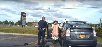 Screen shot of police dash cam showing Ulster County Legislator Jennifer Schwartz Berky getting pulled over by town of Ulster Police Officer Gary Short.