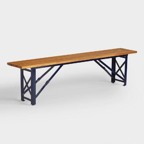 Inspired by the beer gardens of southern Germany, our dining bench creates a casual outdoor oasis to gather with friends and family. It features a deep navy blue steel frame and a slatted acacia wood surface for bold contrast. And thanks to a collapsible design, it folds flat for convenient storage.