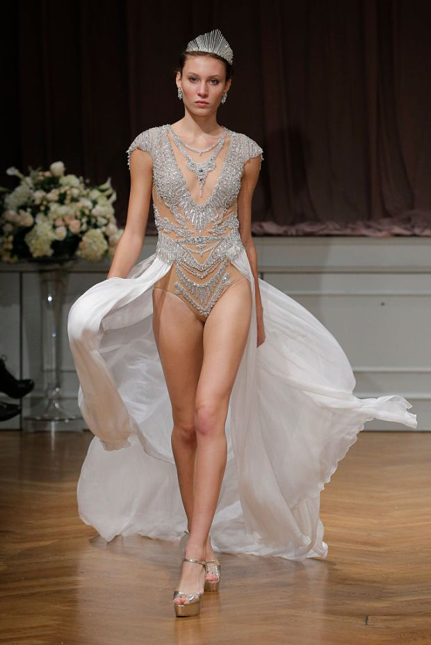 Traditionalists, shield your eyes. This particular wedding dress collection might be a little too jazzy for your tastes.  But for anyone who dreams of dressing like a slightly more low-key version of Beyoncé on their big day, pay attention. Let Alon Livné's latest runway show serve as your ultimate inspiration with bejewelled leotard wedding dresses. Pretty.