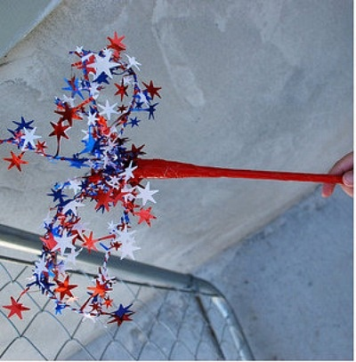 The kids will love waving around their 4th of July fireworks wand craft at their next Independence Day Party.    Materials:  wooden dowel or disposable chopsticks  red ,white, or blue tape like electrical tape  red, white, and blue star wire garland  scissors
