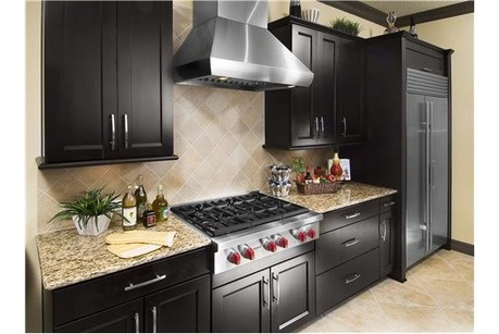 Black cabinets and sleek commercial grade stainless steel - Commercial grade kitchen appliances ...