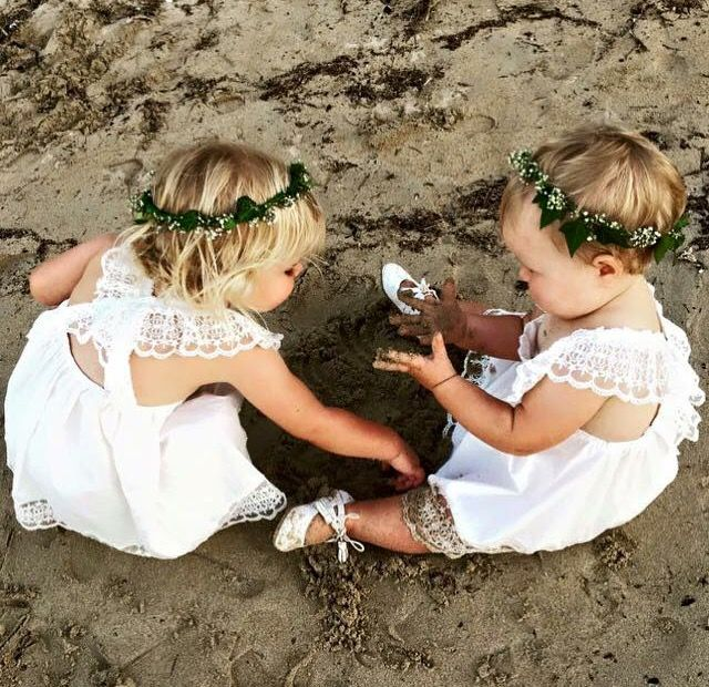 Beach Babe Flowergirl's. Flowergirl dresses available in store at Nora and Elle Bridesmaids.