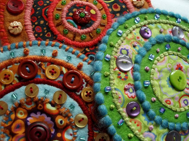 """Appliqued felt and cotton fabrics. Three from a series. Each circle is about 5.5"""" (14cm) diameter."""