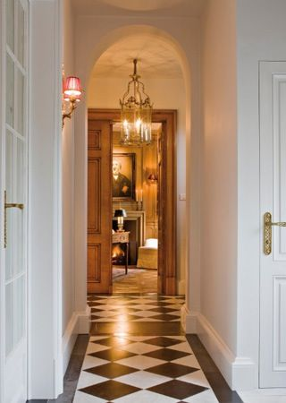 Hall with striking black and white check floor on the diagonal with a black border