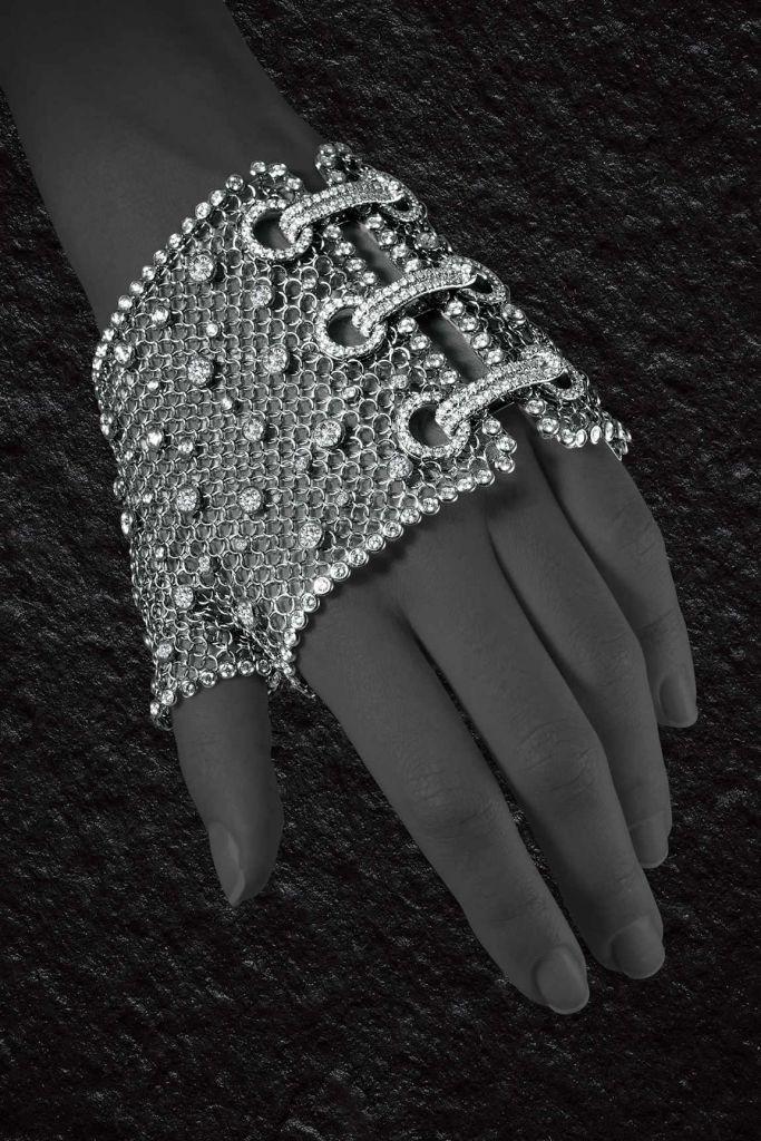 Madonna's white gold and diamond mesh glove by Jacob & Co. #gold #diamond