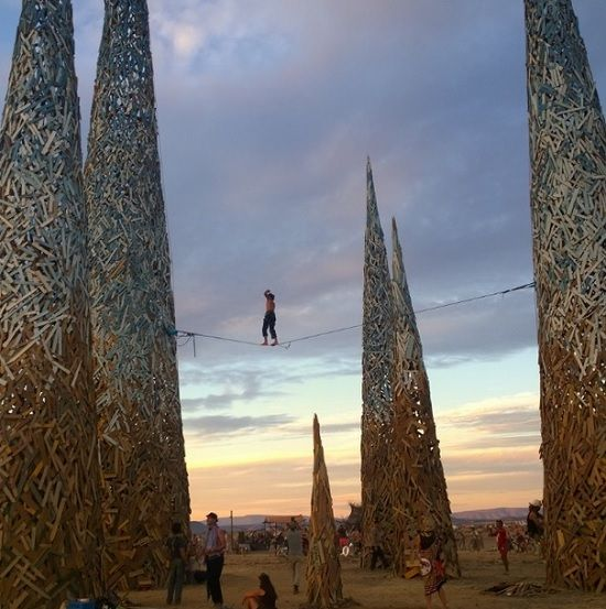 Walking the tight rope across the towers of the temple at AfrikaBurn 2014 - Tankwa, South Africa. Photograph by Dylan Culhane.