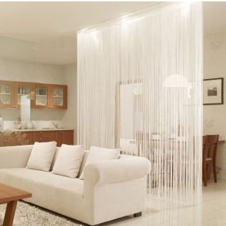 Want to define an area in your studio but don't want to make the space seem choppy with heavy curtains? Try this white string curtain panel. Very cool and allows light to filter through, giving your studio apartment an open feel while still adding some separation and visual interest to the space.