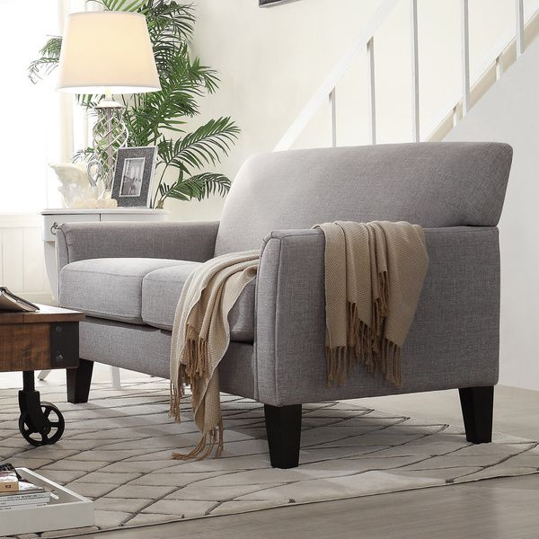 Add stylish seating to your room with this comfortable Uptown Collection. This piece features impeccable style with a tailored look. This loveseat comes with thick cushioning on the seat and back and