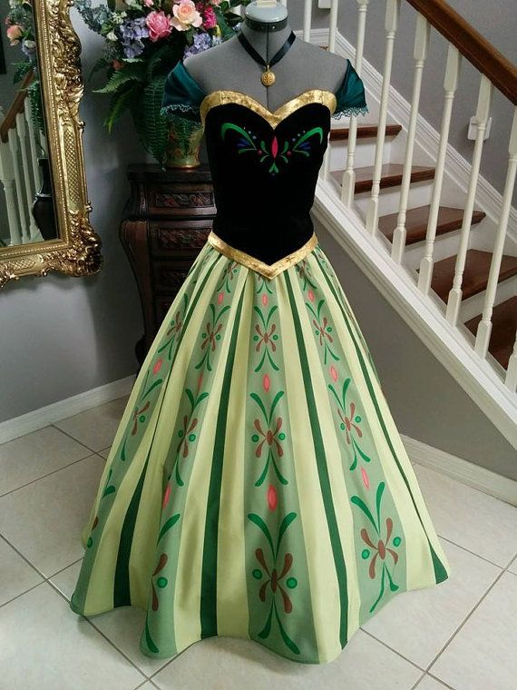This is Annas Frozen Coronation dress. It consists from a corset top and a skirt. The corset is made out of stretch velvet. Embroidered design front and back. The skirt is custom printed. It is an original design created in my company. We did our best to make it as close as possible to the movie one.    Our costumes are custom made for individuals. Therefore you can send us a dress that fits you well and we will create the costume to perfectly match this size. Or we can create the costume to…