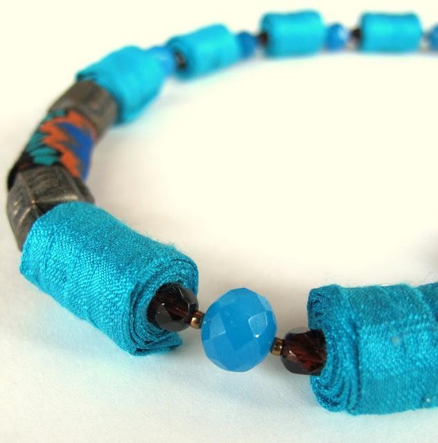 Turquoise flow in a unique fiber necklace