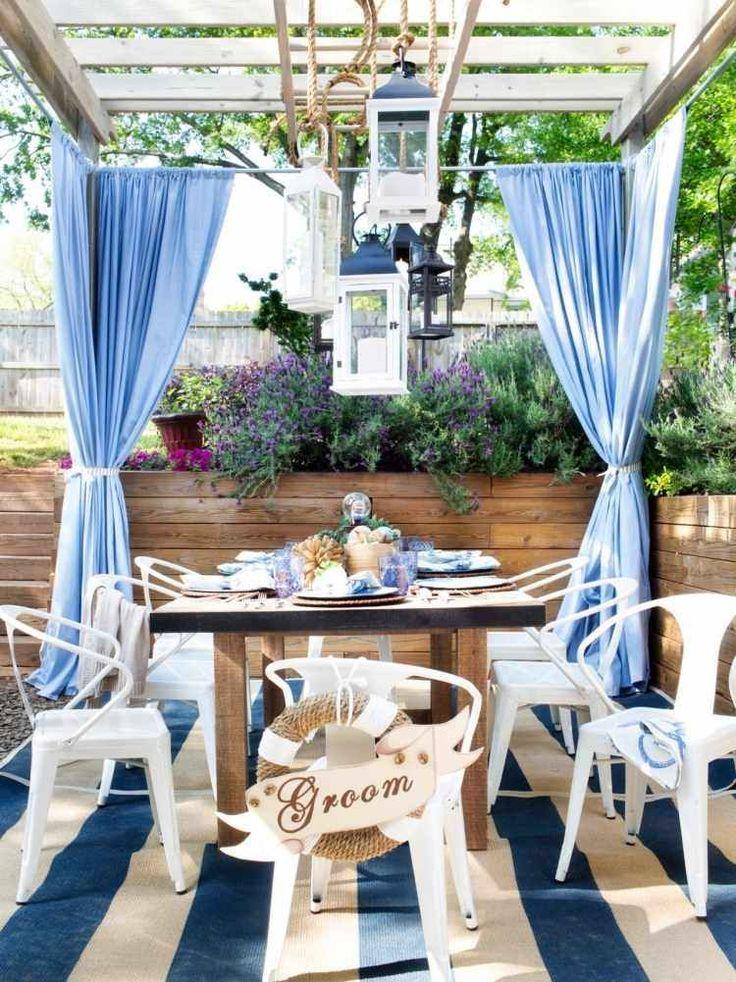 Wooden pergola with curtains dining area in the garden with marine decor | terasa #gradina #decor #albastru http://blog.decoradesign.ro/materiale-textile-de-exterior-imbinarea-armonioasa-intre-util-si-confort/