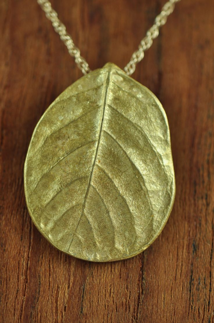 Bright small bronze salal pendant. Salal, a symbol of prosperity, boasts a beautiful leaf that has been captured here in complete pureness. $120