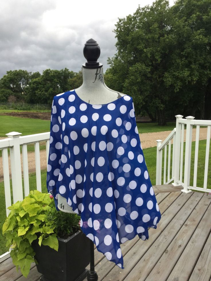 Handmade vibrant royal blue with white polka dots chiffon Lucy wrap.  Super cute with jeans, leggings or as a swimsuit coverup.  Wear over a tank top, camisole or top.  Side slits all the way to hem makes it great to wear under a jacket....arms are free from fabric bunching ..one size fits up to size 24