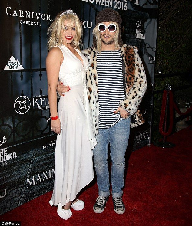 Showstoppers! Mark Ballas and his girlfriend Brittany Jean Carlson dressed as Nirvana frontman Kurt Cobain and wife Courtney Love for Maxim Magazine's Halloween party in Beverly Hills on Saturday