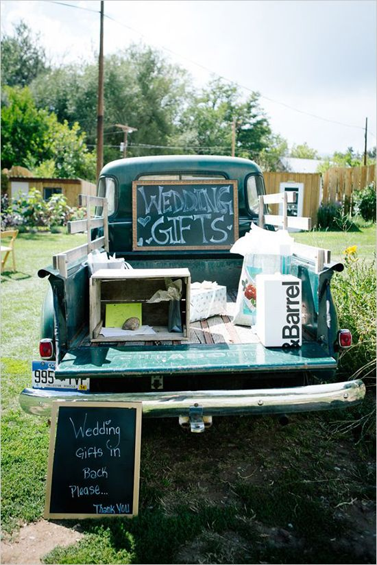 Wedding gifts in back of classic pickup. Captured By: Emily Elizabeth Photo ---> http://www.weddingchicks.com/2014/05/30/wild-and-free-bohemian-wedding/