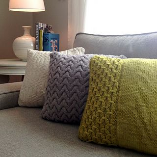 Snap, Crackle, and Pop are three different pillows in one pattern, highlighting three different knitting techniques: smocking, cables, and ribbing/basketweave.