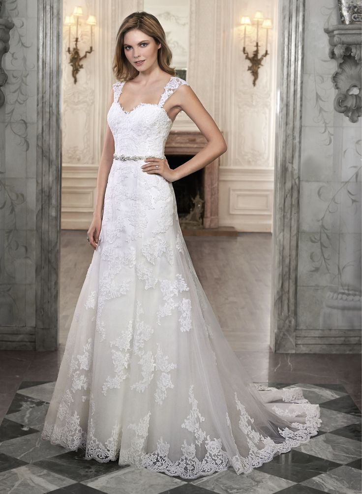 New Marty by Maggie Sottero This A line wedding dress is plete with floral lace appliqu s drifting down a tulle skirt and romantic sweetheart neckline
